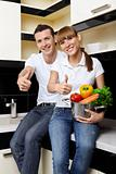 Smiling couple on kitchen