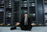 business man practice yoga at network server room