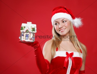 Beautiful girl holds a New Year's toy on palm