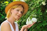Young woman gardening - taking care of snowball