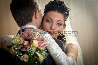 Beautiful bride and groom in indoor setting