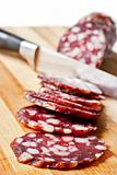 Salami sliced on chopping board