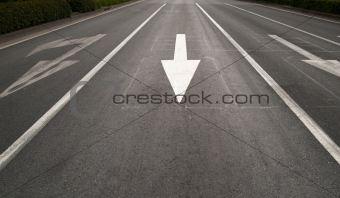 Arrow sign on road