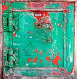 Stained green metal door