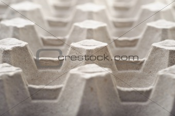Empty cardboard egg holder, abstract stucture background