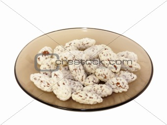 Almonds in sugar isolated on a white background