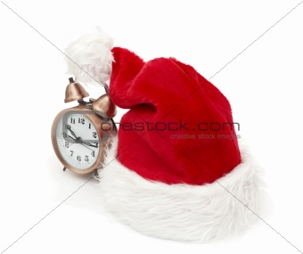 Alarm clock on the hat of Santa Claus