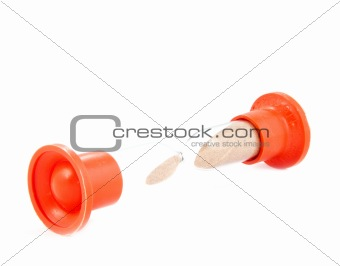bright orange recumbent sand glass over white closeup