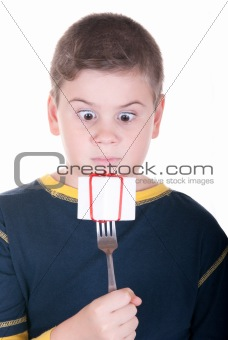 Boy looks at a plug with a gift