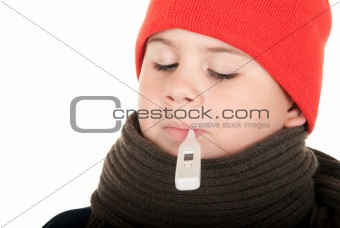 Boy takes temperature thermometer