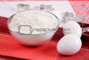 Form for baking, flour and eggs. We prepare cookies.