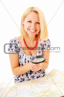 Beautiful young smiling girl with magnifying glass and map