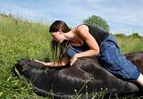 horse laid down and girl