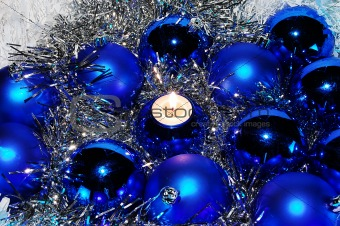 Blue Christmas baubles and a candle