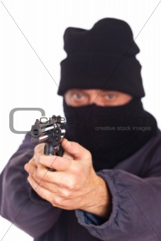 Thie Aiming a Gun on a Robbery