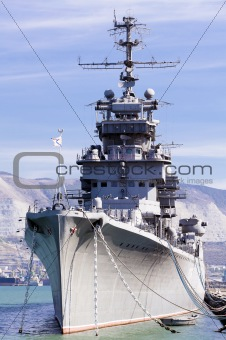 Battleship docked at a harbor
