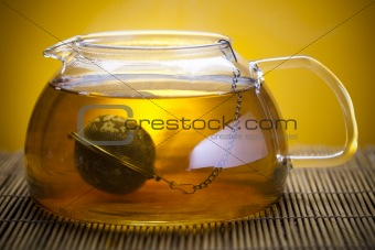 Glass teapot of tea