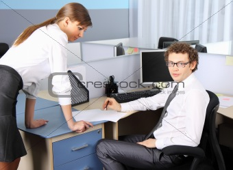 Business woman and her colleague working at office