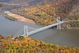 Autumn Mountain forest with bridge