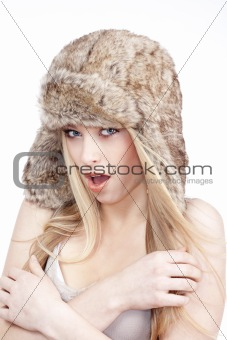 beautiful blond girl with blue eyes in fur hat - isolated on white