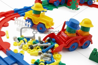 Toy bulldozer and railway on white background