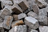 Pile of natural gray stone bricks closeup