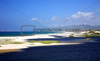 Beach with white sand in Sardinia, Italy.