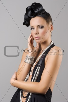 sensual brunette girl with necklace and hair style