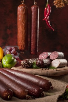 A composition of different sorts of sausages on dark background