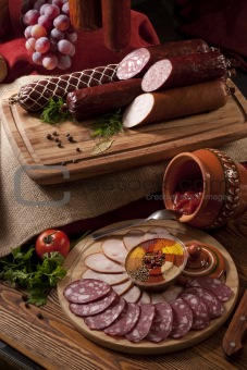 A composition of different sorts of sausages on the table