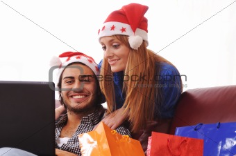 young couple and christmas shopping