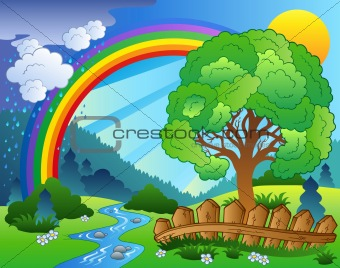 Landscape with rainbow and tree