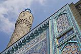 The minaret and the front wall with Arabic mosaics of the ancien