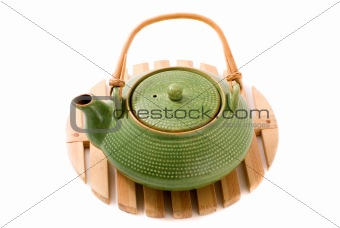Green teapot on stand