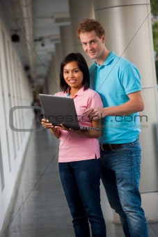 Attractive Students Laptop Both Looking Campus