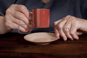 old hands and coffee cup
