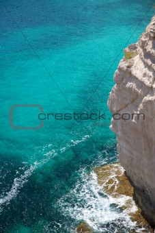 great cliff and green water