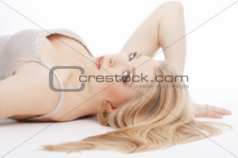 beautiful young woman lying down, looking- isolated on white