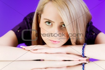 Attractive blond girl against colourful background
