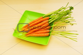 Fresh carrots on the wooden table