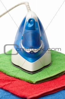 Flat smoothing iron on coloured bath towels