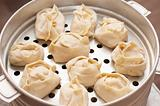 Kirghiz oriental dumplings on metal steam cooker