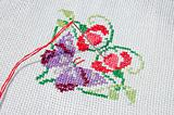 Needlework. Cloth with needle, thread and embroidered batterfly