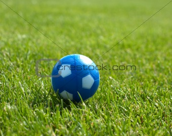 Small blue soccer ball against goal in background