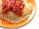 Spaghetti with meat in ketchup on orange plate