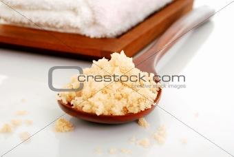 bath salt on a wooden spoon closeup