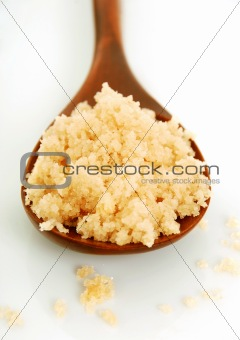 bath salt on a wooden spoon closeup