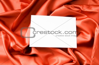 Blank message on the red satin background