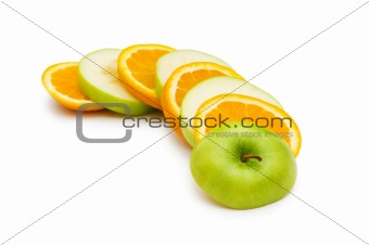 Sliced orange and apple isolated on the white