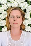 Young woman laying in flowers - snowballs